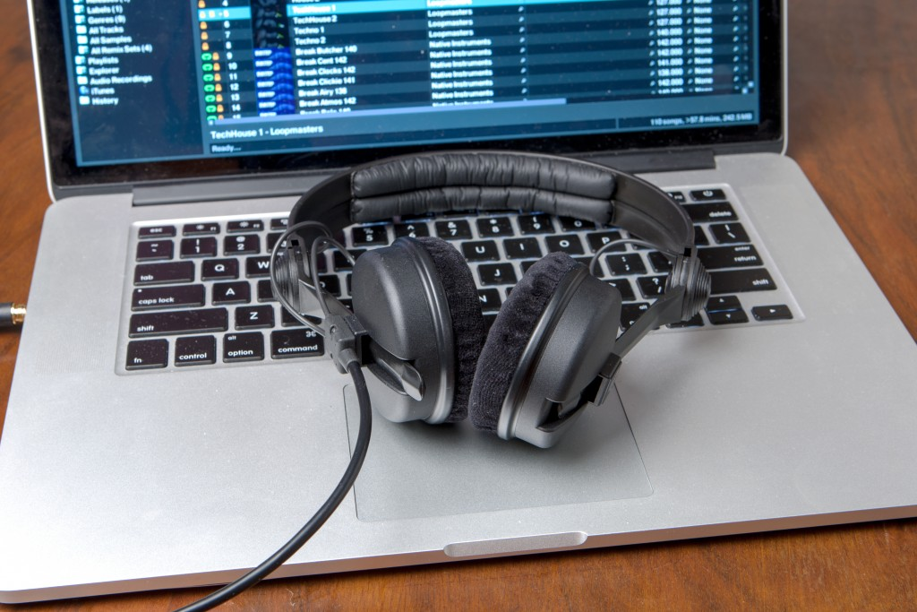 Image of a laptop with music and headphones